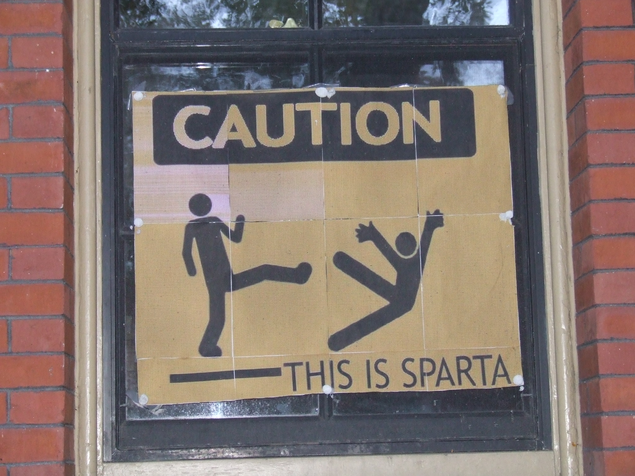 Stick figure kicking another stick figure with caption 'This is Sparta'